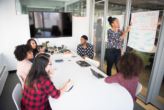 women of colour discussing in a meeting room
