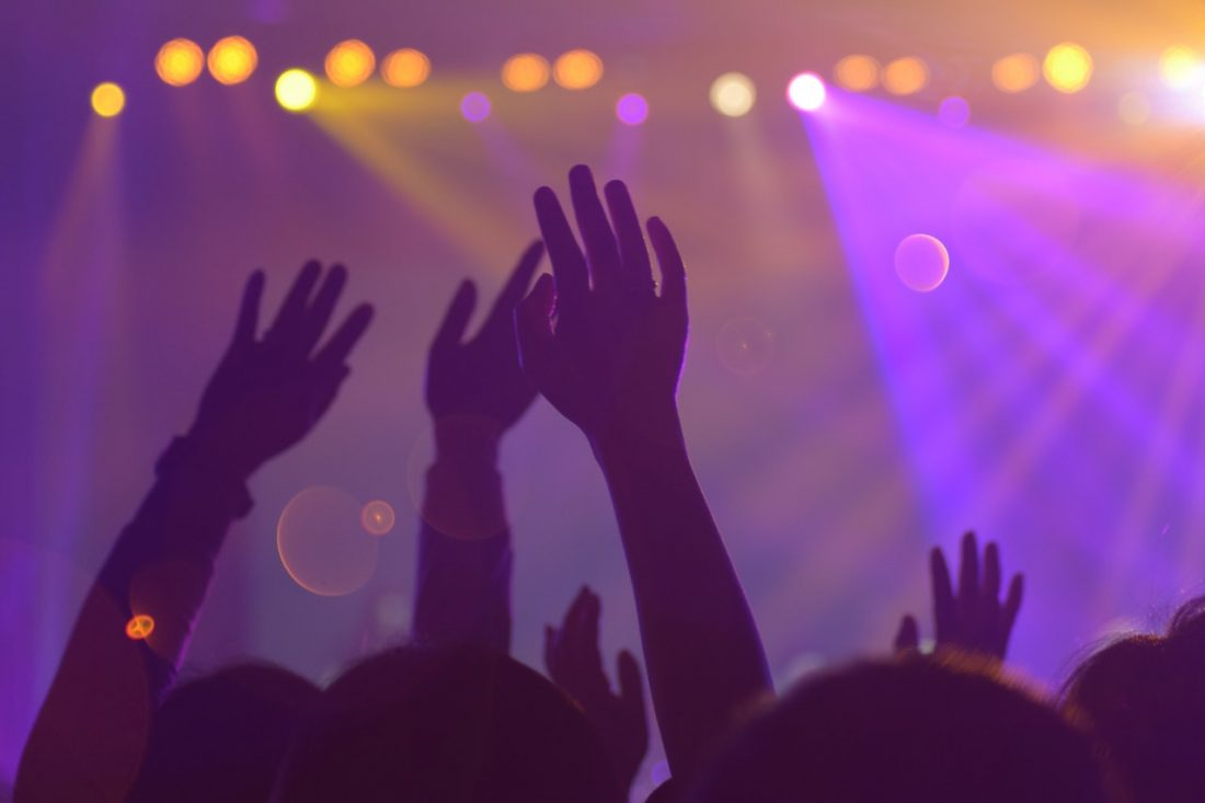 group of people hands up concert kabutakapua pexels attention blog post